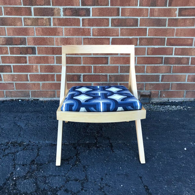 Two one of a kind blonde modern side chairs with custom retro mod cushions. These fraternal twins are surprisingly...