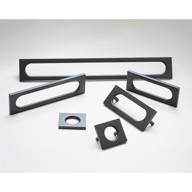 Our largest mod handles echoes the long curved lines of mid-century automobile fenders. Substantial enough for larger...