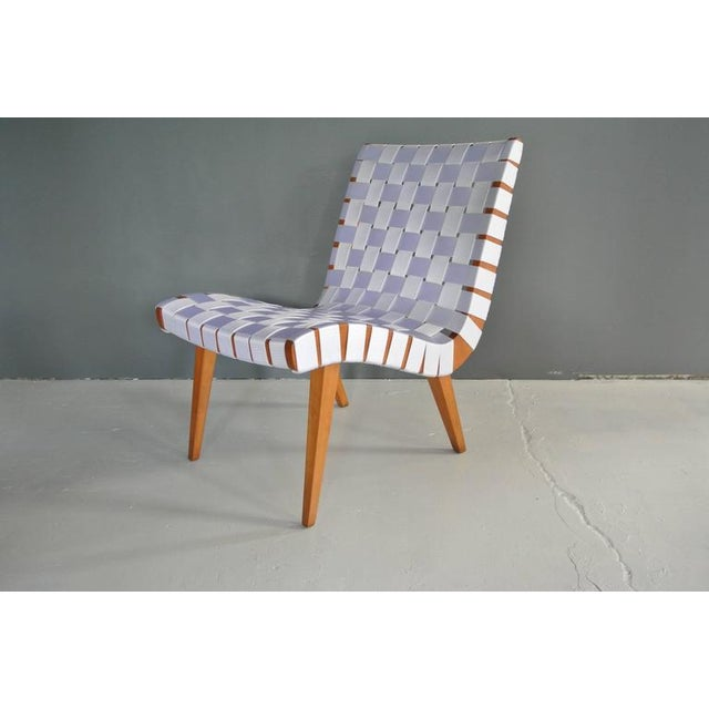 Newly refinished webbed lounge chair in birch by Jens Risom. Webbing is a white vinyl. Signed Knoll International.