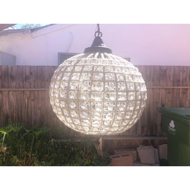 Old World glamour of classic European design. The Globe chandelier's faceted glass beads sparkle and illuminate a bedroom,...
