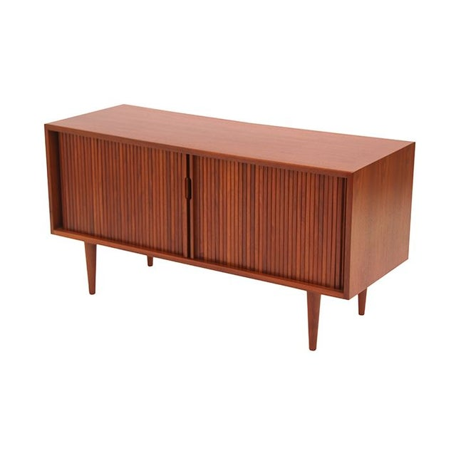 A fab walnut tambour door credenza designed by Milo Baughman- we're his biggest fangirls! Manufactured by Glenn of...