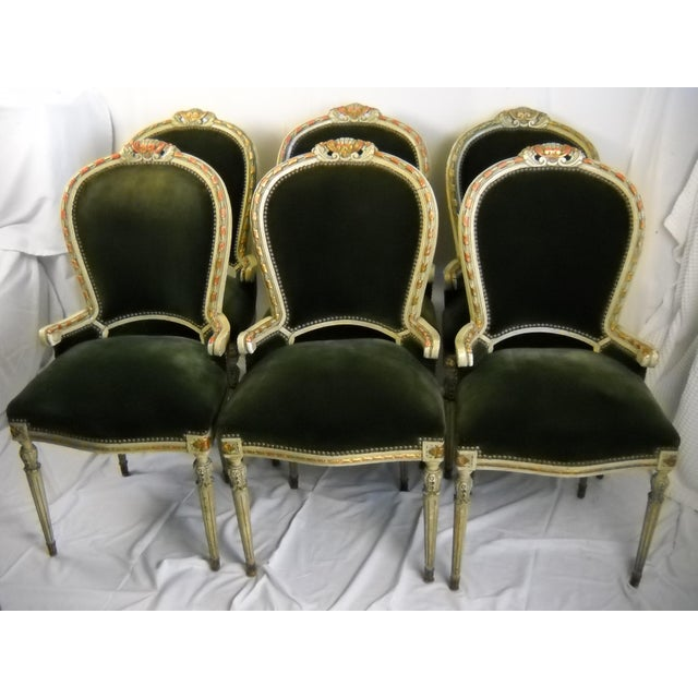 Set of six French giltwood chairs with original finish on frames and velvet upholstery, circa-1950's. Each chair is richly...