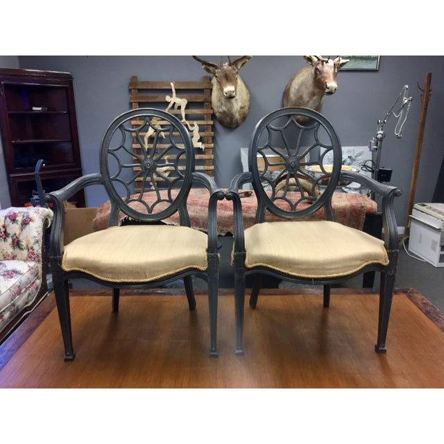 Stunning wheel back chairs in the style of Robert Adam. Newly upholstered with a rope twine. Very stunning chairs.