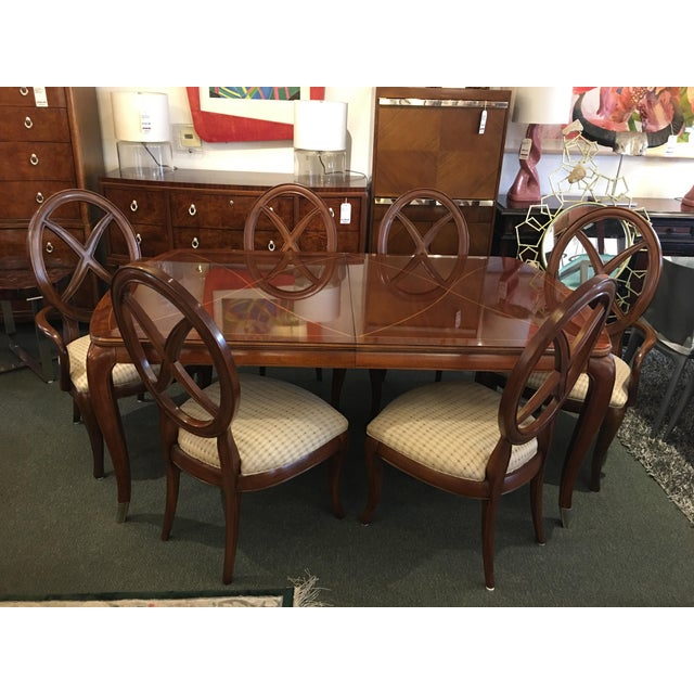 Design Plus Consignment Gallery presents a Thomasville dining set composed of a premier finished table + 6 splat back...