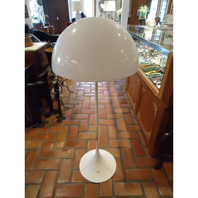 This Classic tulip floor lamp with its mushroom shade is iconic. This is an original signed Mid-Century piece not a...