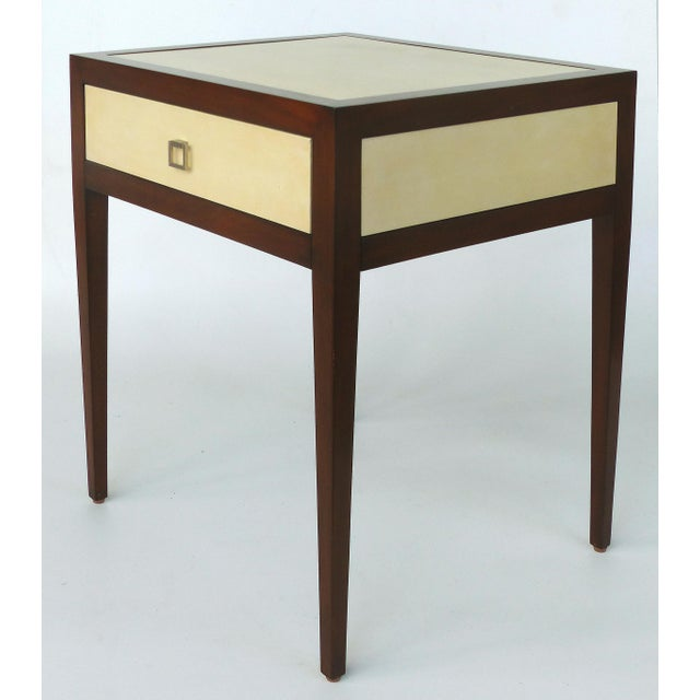 Offered for sale is a Williams & Sonoma Home mahogany and parchment side table. The table has inset parchment panels on...