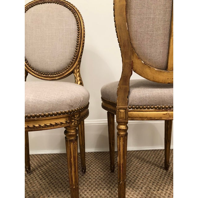 This is a really special pair of vintage French gilt oval back chairs. The gold finish has great depth and sheen. They are...