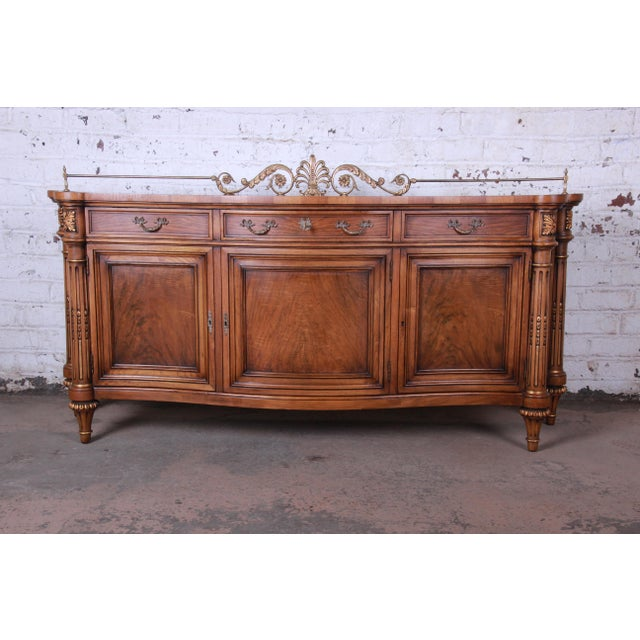Offering an exceptional French Louis XVI style sideboard, credenza, or bar cabinet by Karges. The sideboard features...