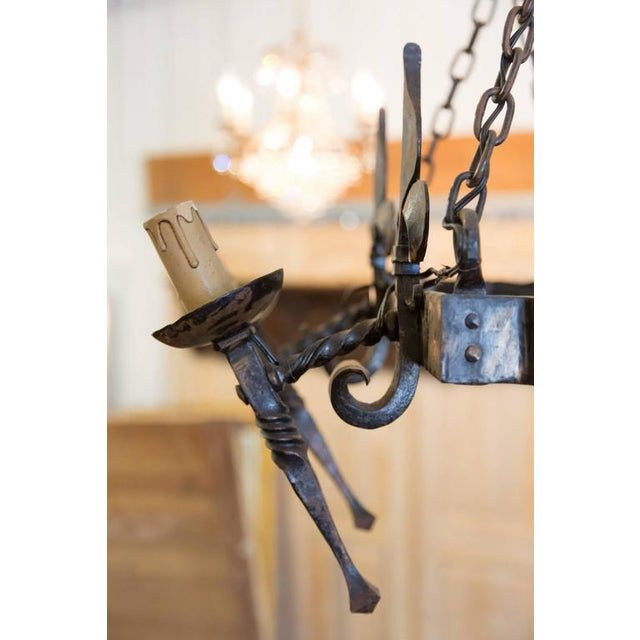 French Country Four Light Hand-Forged Iron Fleur De Lis Chandelier For Sale - Image 9 of 10