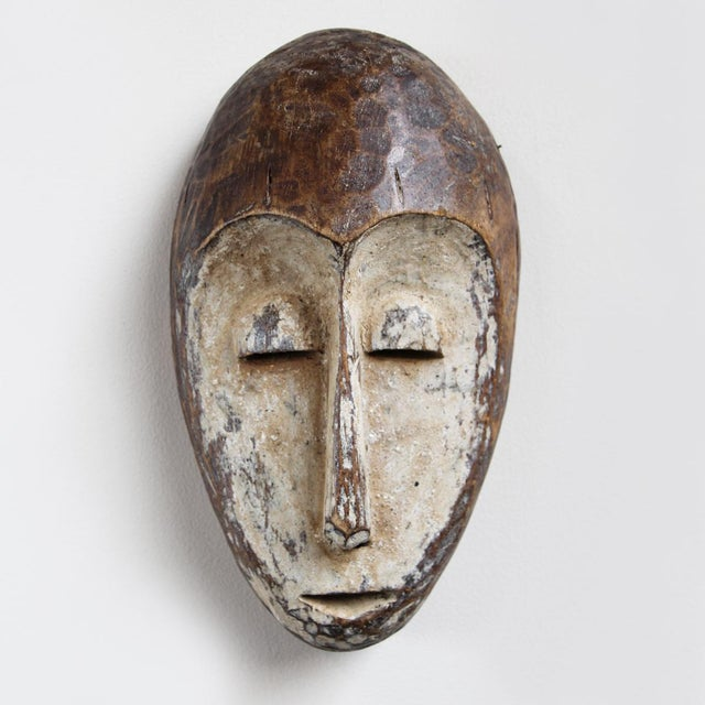 Lega wood carved tribal mask from Dominican Republic of Congo in Central Africa. These masks are symbols of the owner's...