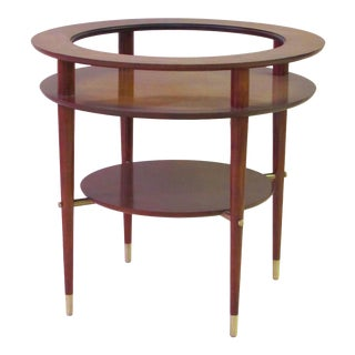 A stylish and sleek Italian mid-century circular side table with glass top and brass fittings