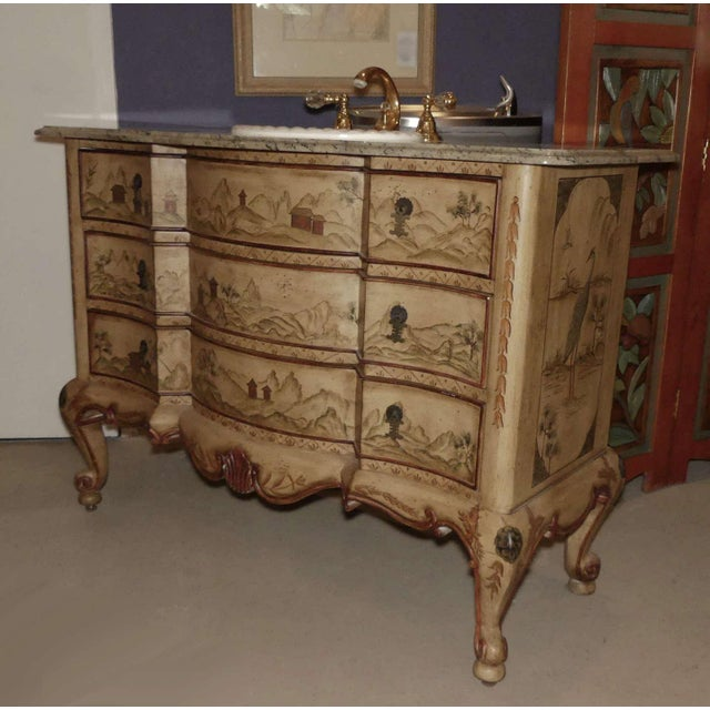 A paint decorated Asian Chinoiserie chest which has been converted into a sink vanity. Painted in tones of tan, beige,...