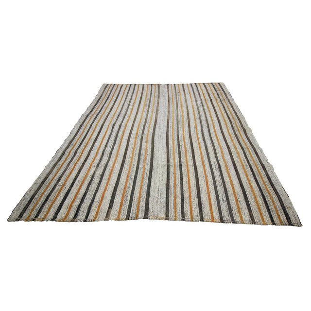 Striped handwoven vintage kilim rug from Adana region of Turkey. Approximately 45-55 years old. In very good condition