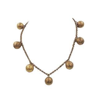 "Monet ""Hindu Bells"" Ad & Book Piece Necklace, 1937 For Sale"
