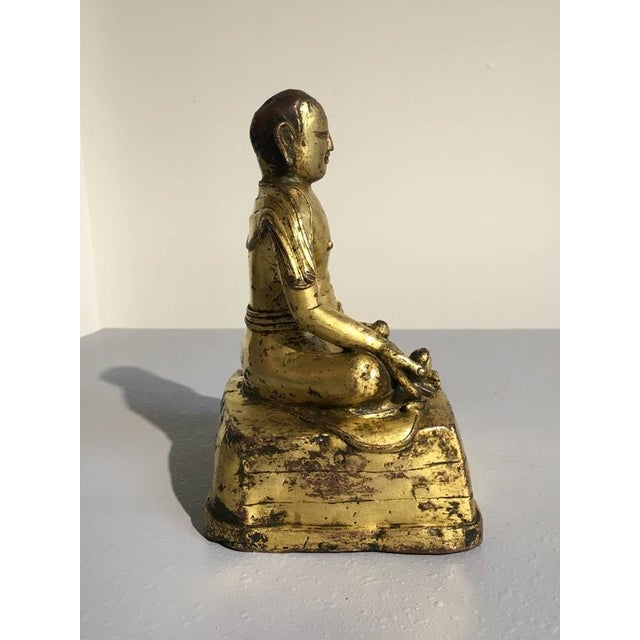 Asian Tibetan Gilt Bronze Figure of an Arhat For Sale - Image 3 of 10