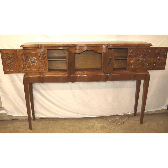 Carved Walnut French Console, circa 1930 ( the legs were custom made at a later time) .; this is a very interesting piece...