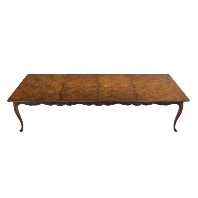 Very nice excellent condition dining table by Baker with two 27x46 leaves.