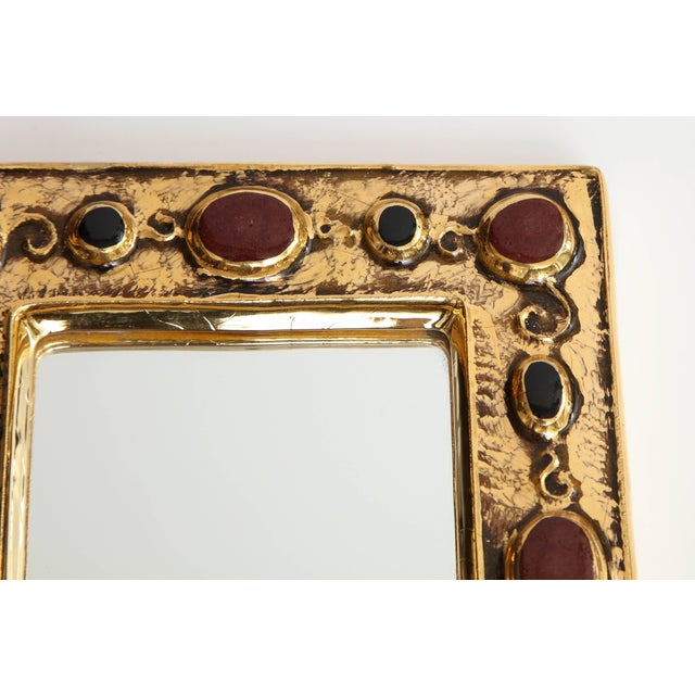 A jeweled François Lembo mirror.