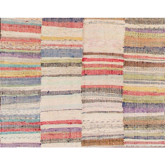 "Vintage hand-knotted Turkish flatweave carpet with a pale-toned, multicolored striped field, 4'10"" x 9'2"""