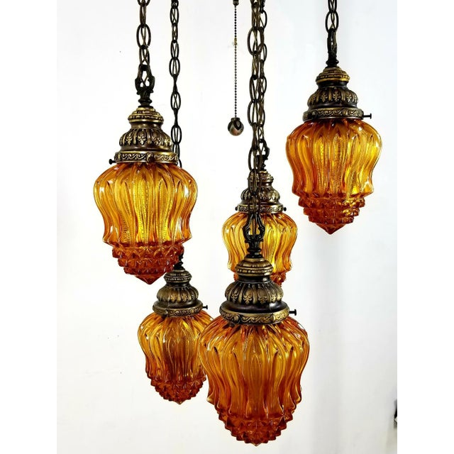 Vintage Hollywood regency 5 globe amber glass hanging lamp in superb Condition. This is an amazing find! Very Rare and...