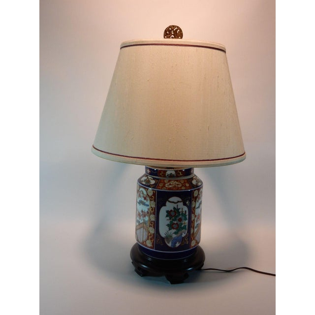 Gorgeous Japanese Imari ginger jar lamp. Has lovely silk shade and cool Asian brass finial. Newer wiring with 3 way switch.