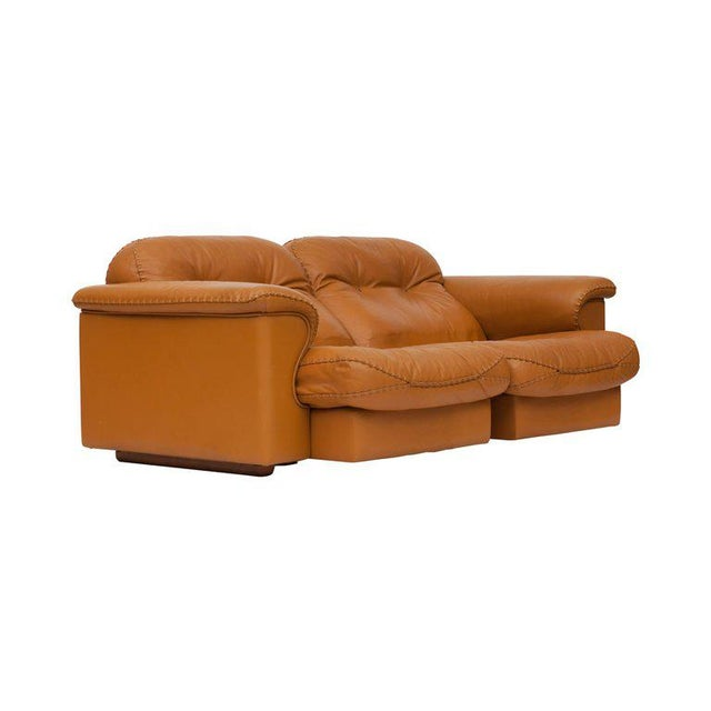 Adjustable and comfortable two-seater sofa by De Sede. The sofa is provide with a high quality brown leather and...