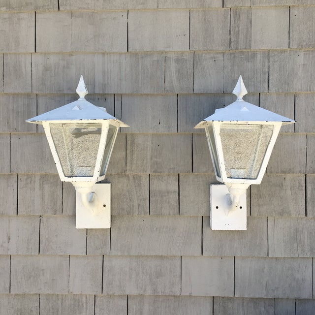 Pair of outdoor lanterns, post-war 1940's-50's. Cast aluminum with old paint and porcelain sockets. Beautiful traditional...