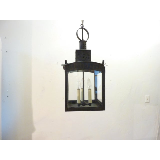 19th Century American pierced design, tin lantern, once used with a candle, now with updated interior light fixture and...