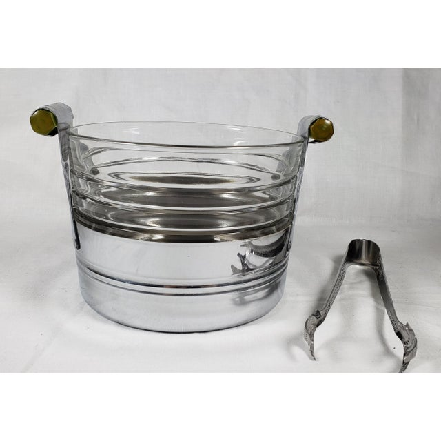 This great-looking Art Deco ice bucket will add a touch of style to your cocktail hour. It features a chrome...