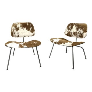 1950s Early LCM Cow-Hide Lounge Chairs by Charles Eames - a Pair For Sale