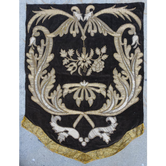 19th Century Italian Gold and Silver Metallic Appliqued textile on chocolate colored velvet. The textile depicts large...