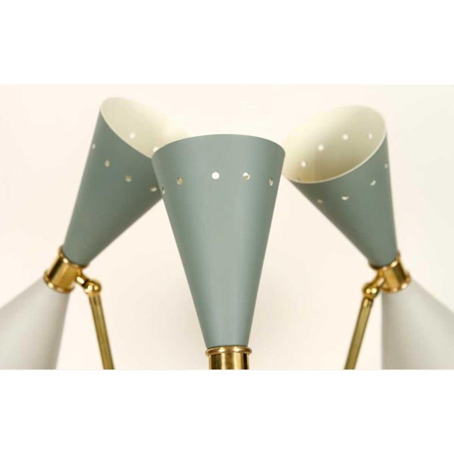 1970s Italian three light brass table lamp having pierced enameled shade in two tones brass arms resting on marble base.