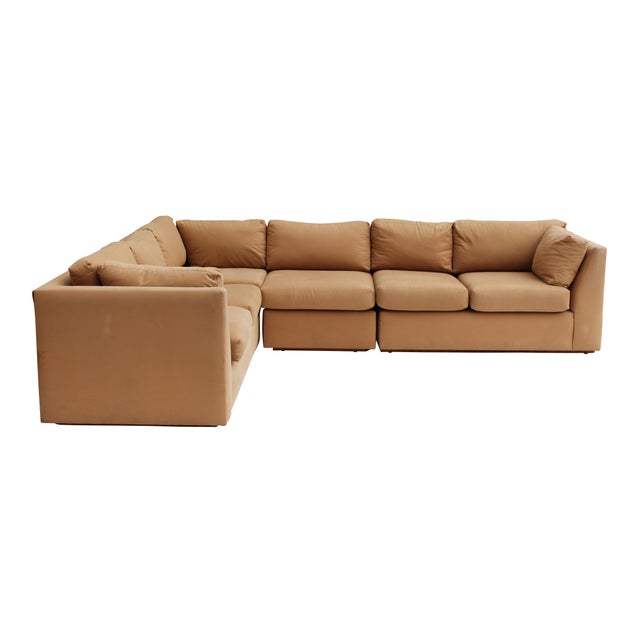 USA, 1970s Modern Sectional Sofa in khaki cotton. Sectional consists of a long sofa (could be standalone), a two seat...