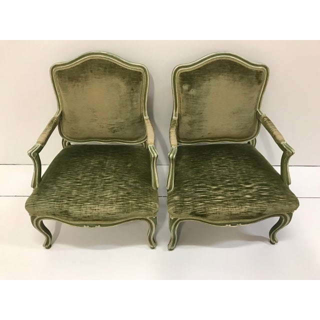 Sweet pair of painted frames with a well worn green velvet. Color of paints are Ivory and Avocado green and looks to be...