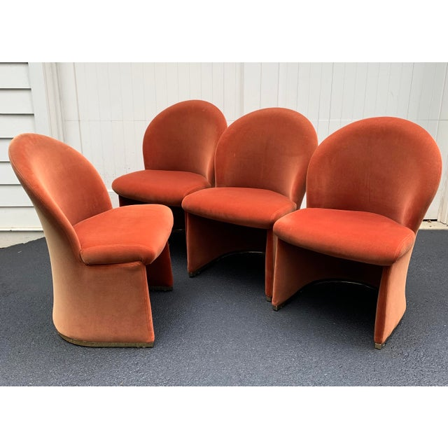 Fantastic set of super comfortable velvet chairs. Upholstered in a burnt orange velvet with a brass plinth base. Sexy...