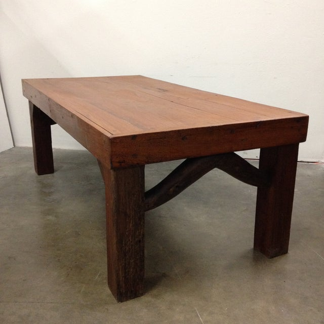This classic coffee table is made with dowel detailing and a unique tree branch swag on each end. It is a solid Arts and...