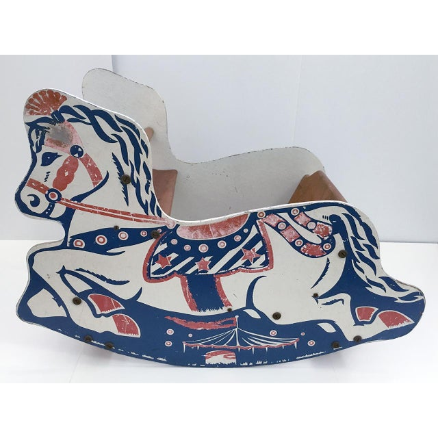 Children's wooden rocking horse chair. Painted red, white and blue with circus theme. Piece shows age and wear, great...