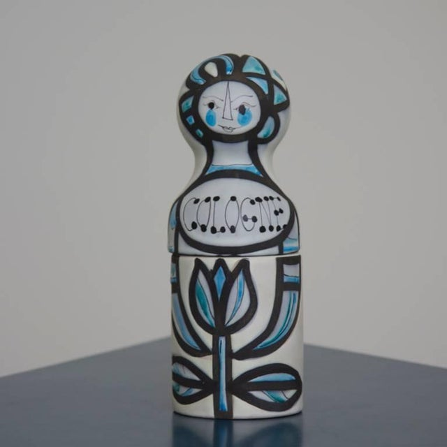 Mint condition Roger Capron cologne bottle for Vallauris in a rare double motif (flower & woman) with a 3d glacier. No...