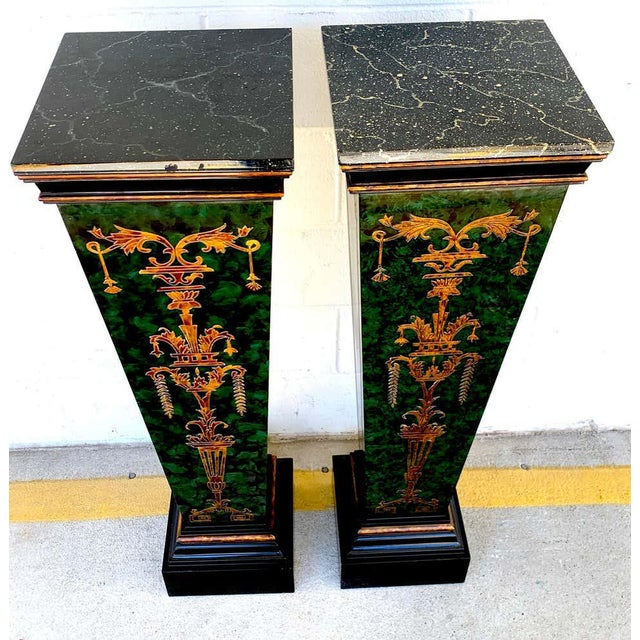 Pair of faux painted green and gilt neoclassical pedestals, each one with a 12-inch square marbleized top, on a tapering...