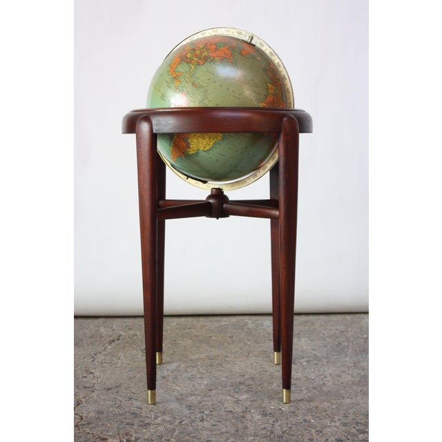 1960s Replogle (Chicago, IL) globe on stand composed of paper gores over glass with a cast metal meridian. Base is...