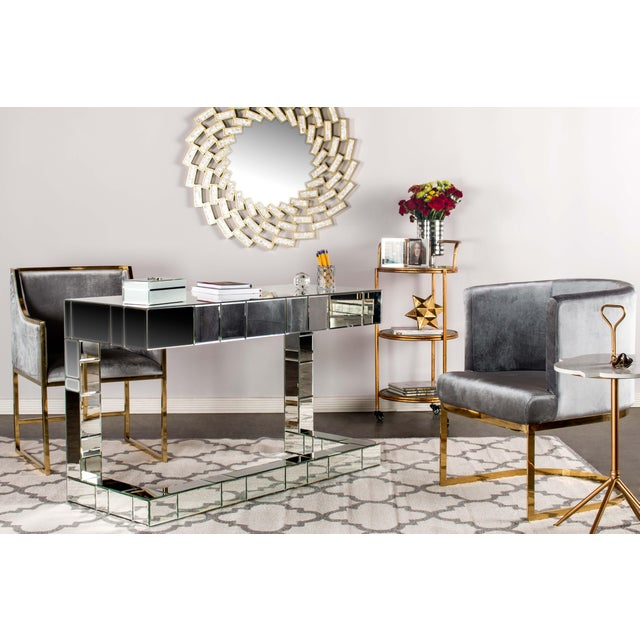 Update your decor with these darling dining chairs made of gold stainless steel base and gray velvet upholstery. They are...