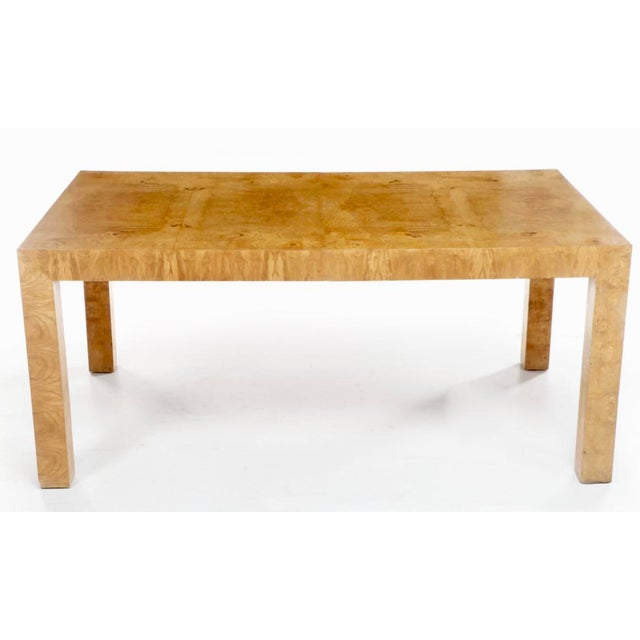 A large olive burl dining table designed by Milo Baughman for Thayer Coggin. In excellent condition. The table is...