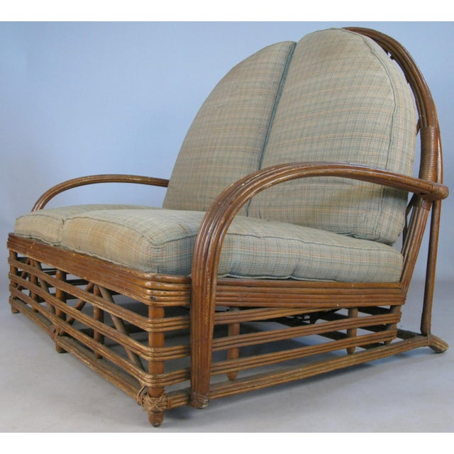 An outstanding antique 1940s rattan settee by Heywood Wakefield. One of their most beautiful designs, with a wide rattan...