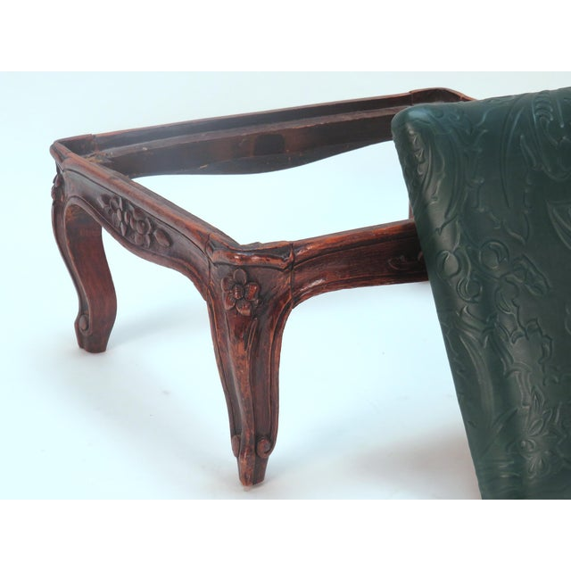 Foot stool with carved flowers on curved legs. Top is upholstered in an embossed green leather. We are pleased to offer...