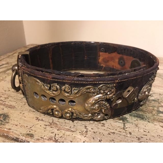 Large leather dog collar with wonderful scrolled brass, heavy. This collar is very ornate and the dog must have belonged...