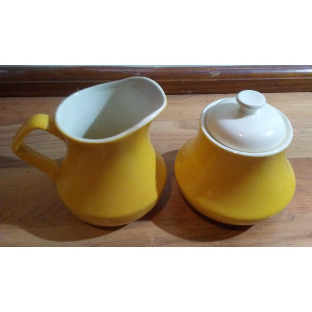 Vintage ceramic yellow and white creamer and lidded sugar bowl. Retro style. Very nice item