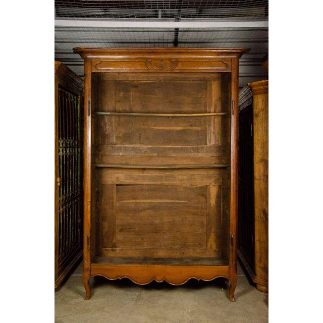 This stunning 19th century Louis XV antique French carved mahogany armoire is a perfect example of classic style and...