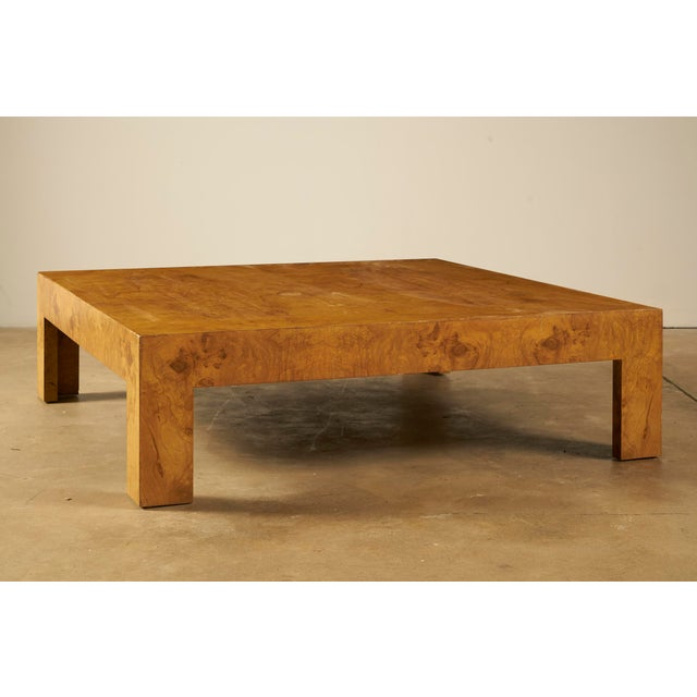 Large and visually substantial olive burl wood coffee table, attributed to Milo Baughman for Thayer Coggin. Table shows...