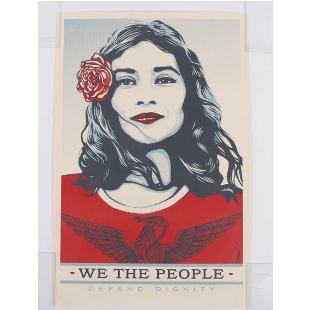A group of three serigraph prints on paper titled -We The People Defend Dignity, We The People Protect Each Other, and We...