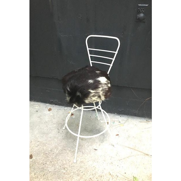 Vintage 1950s-60s midcentury white iron counter stool/chair with goat hide seat. Excellent condition.